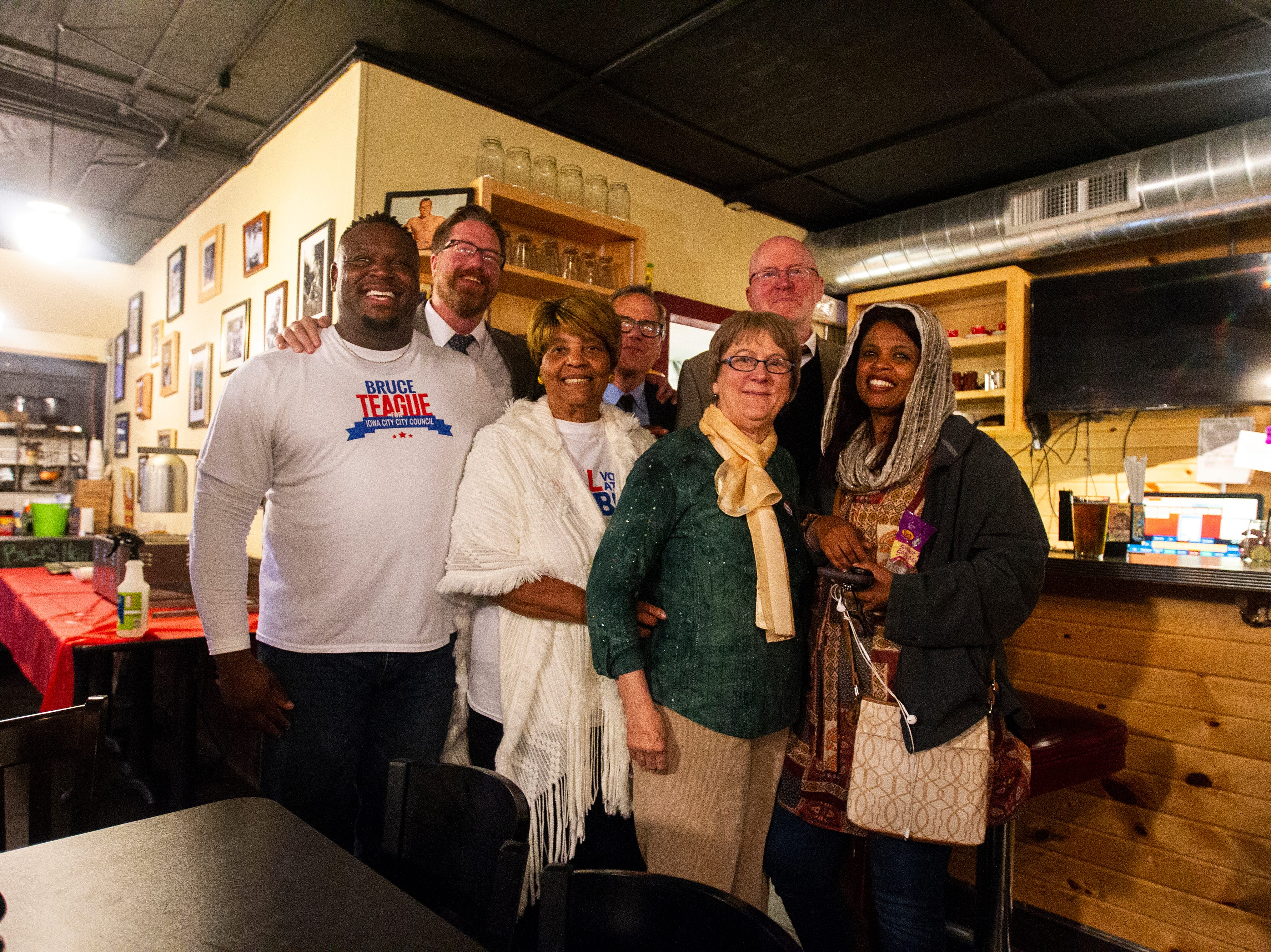 Bruce Teague poses for photos with Rockne Cole, Mary Teague, John Thomas, Pauline Taylor, Jim Throgmorton and Mazahir Salih on Tuesday, Oct. 2, 2018, at Billy's High Hat Diner on Iowa Avenue in Iowa City.