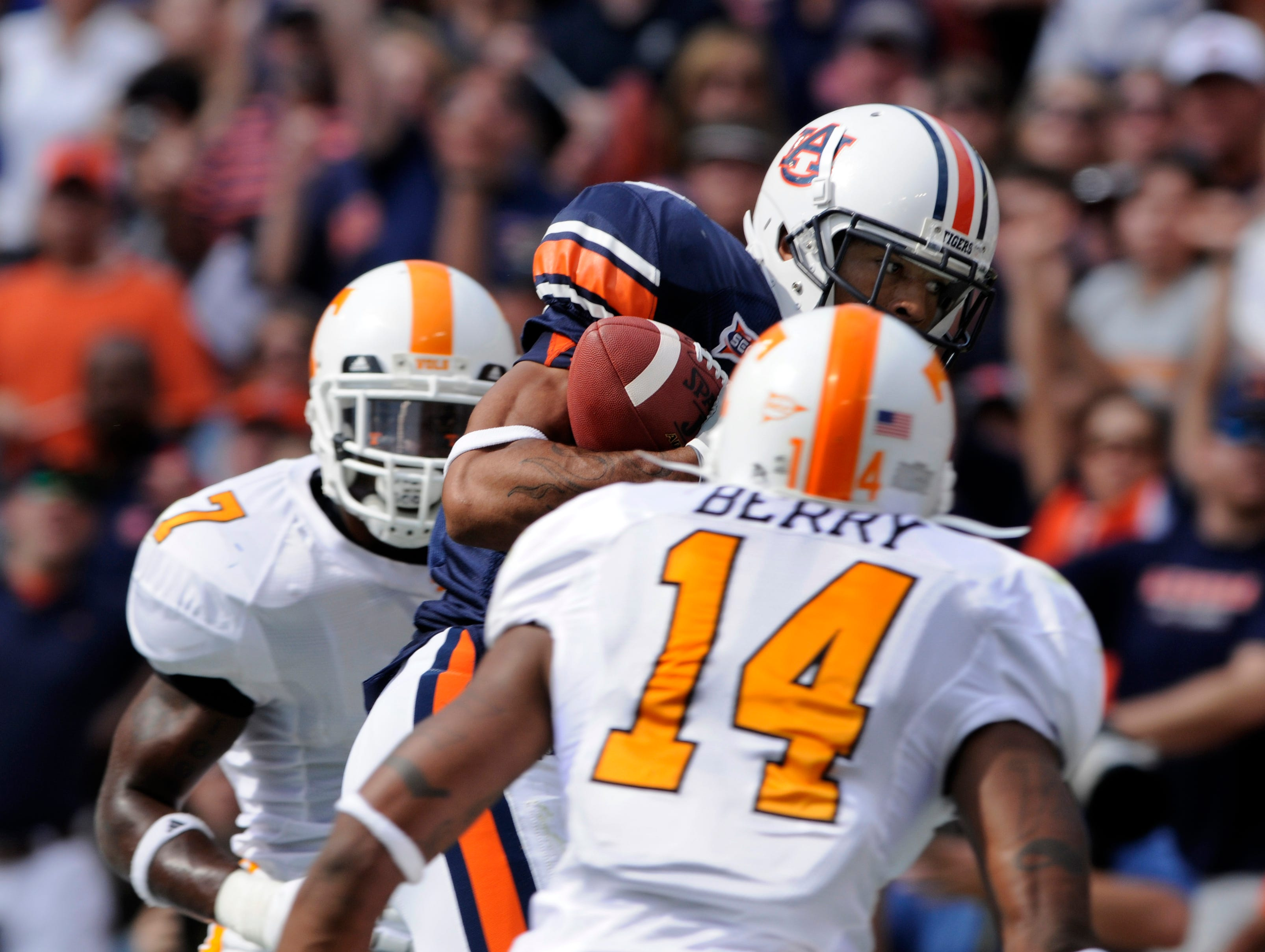 MICHAEL PATRICK/KNOXVILLE NEWS SENTINEL - Saturday, September 27, 2008  Auburn wide receiver Robert Dunn (3) catches an 18-yard touchdown pass between Tennessee defensive back Demetrice Morley (7) and safety Eric Berry (14) Saturday at Jordan-Hare Stadium in Alabama. Auburn won the game 14-12, dropping Tennessee to 1-3 for the season.