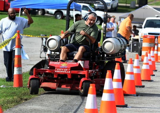 Jeff Hamilton competes on a lawnmower in the equipment rodeo held by City of Knoxville public service department Wednesday.