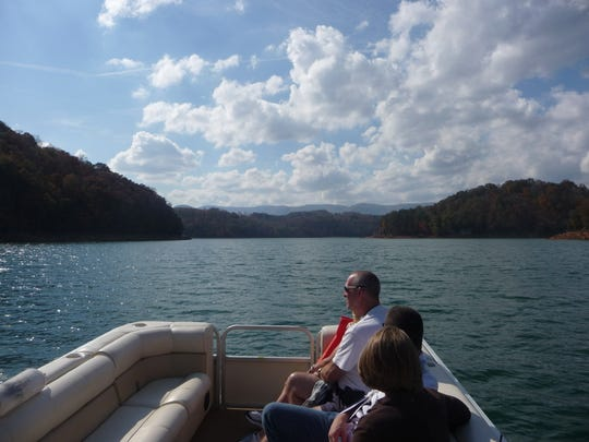 Passengers watch the shoreline pass by on a trip at Norris Dam State Park.