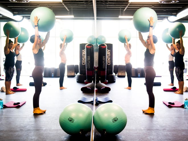Thrive Functional Fitness founder and instructor Carole Mathews leads a class at their space at Bullman's Fitness Studio in Knoxville on Oct. 3.
