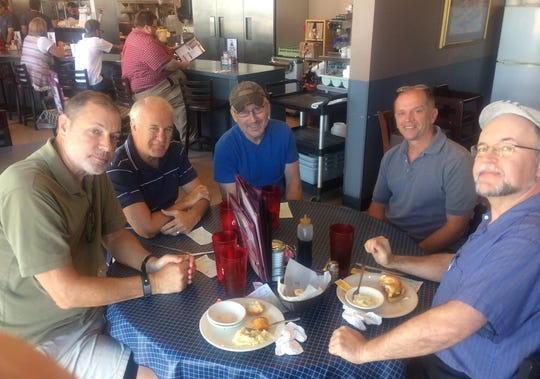 Current and former News Sentinel staff enjoy lunch at Pete's. From left, Mike Strange, Steve Ahillen, Dan Fleser, Don Wood and Randall Brown.