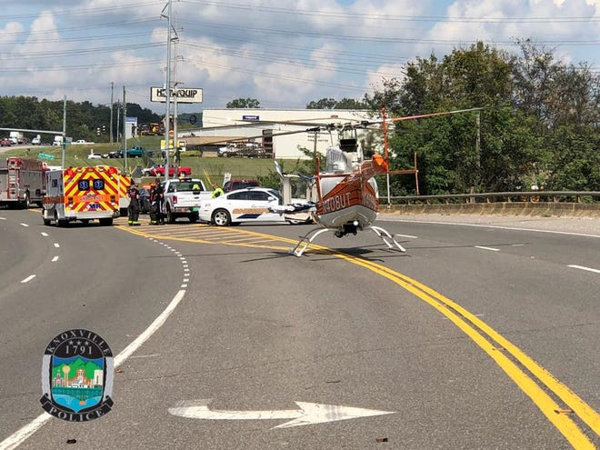 A Lifestar helicopter lands at the scene of a crash that injured two people in Northeast Knoxville on Sept. 3, 2018.