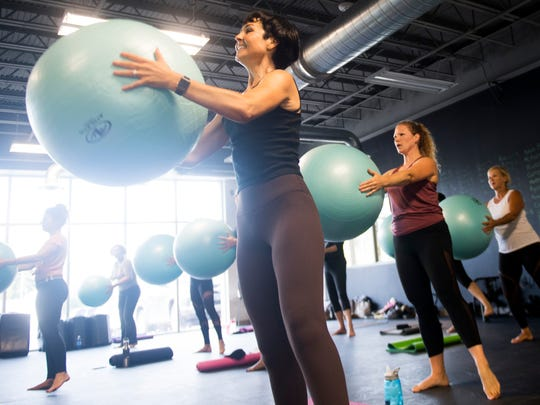 Thrive Functional Fitness founder and instructor Carole Mathews, left, leads a class at their space at Bullman's Fitness Studio.