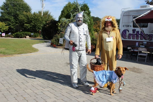 """Howl-o-ween isn't just for the dogs but for their owners as well as this """"Wizard of Oz"""" inspired photo from 2017 shows."""