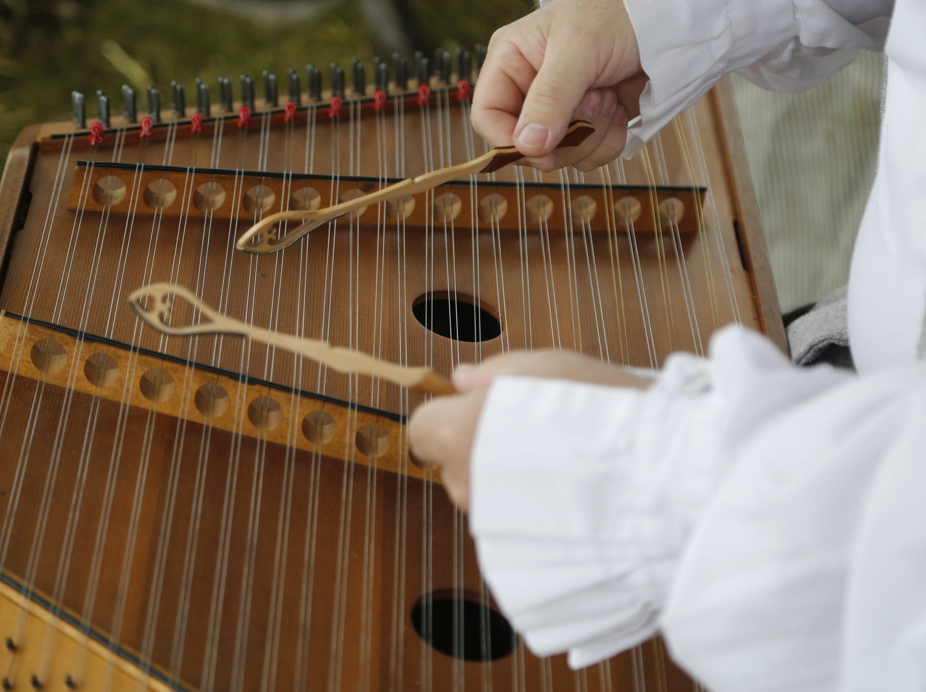 Musician Tim Schaiper plays a tune on his hammered dulcimer during the Feast of the Hunters' Moon Saturday, October 1, 2016, at Fort Ouiatenon. Schaiper, who is from Miamisburg, Ohio, has been coming to the Feast for the past eight to ten years.