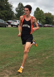 Brighton's Zach Stewart was second with a time of 15:38 in a tri meet against Plymouth and Novi at Cass Benton Park on Tuesday, Oct. 2, 2018.