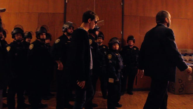 """A still from Nick Stumphauzer's documentary """"How to Kill 14 People without Saying a Word"""" shows conservative provocateur Milo Yiannopoulos on Feb. 1, 2017, when his speech at University of California, Berkeley was cancelled after violent and destructive protest erupted."""