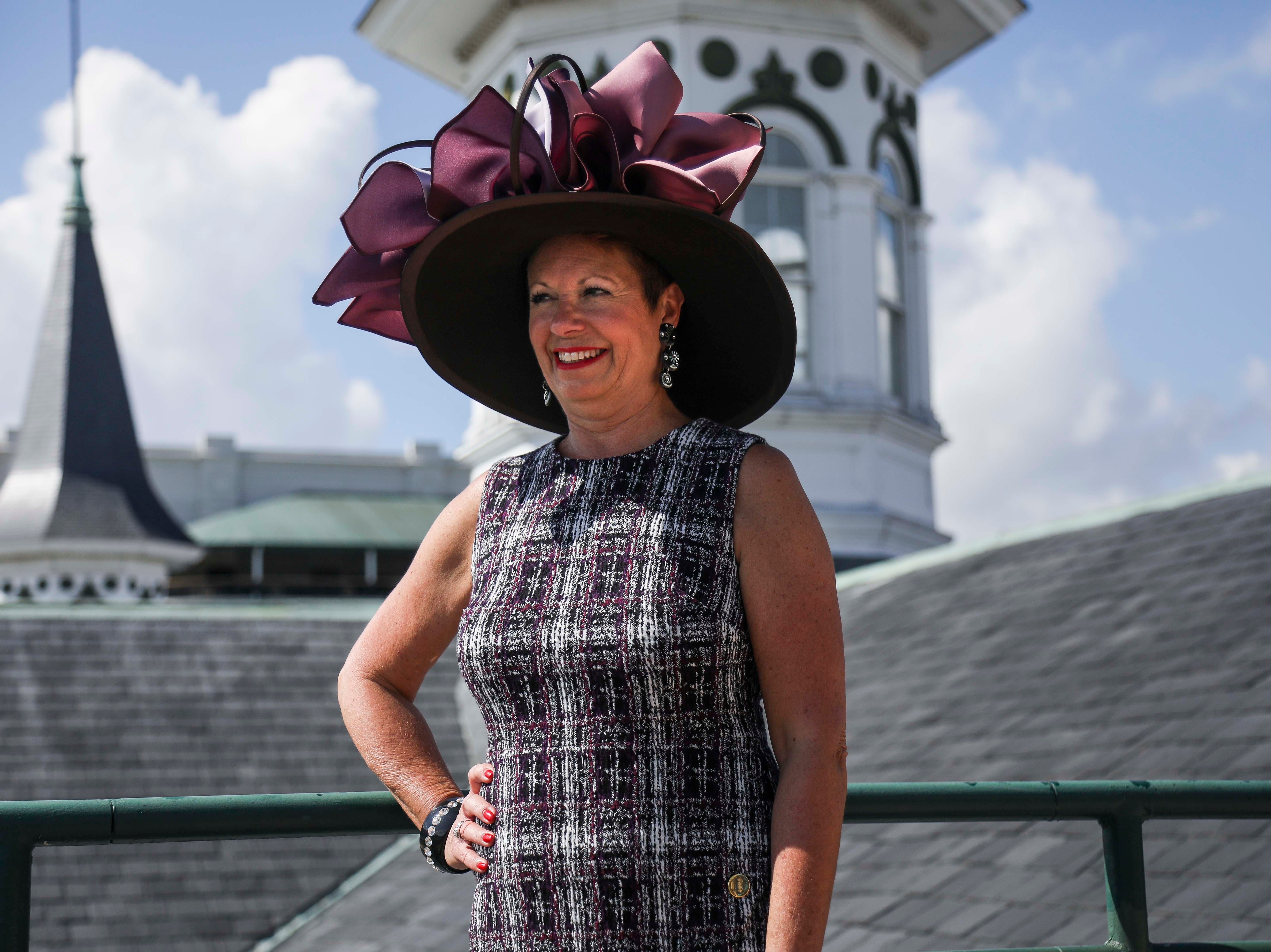 Patty Ethington models one of Christine Moore's handmade Cam Hats at Churchill Downs as well as a DNKY dress on Wednesday, October 3, 2018.