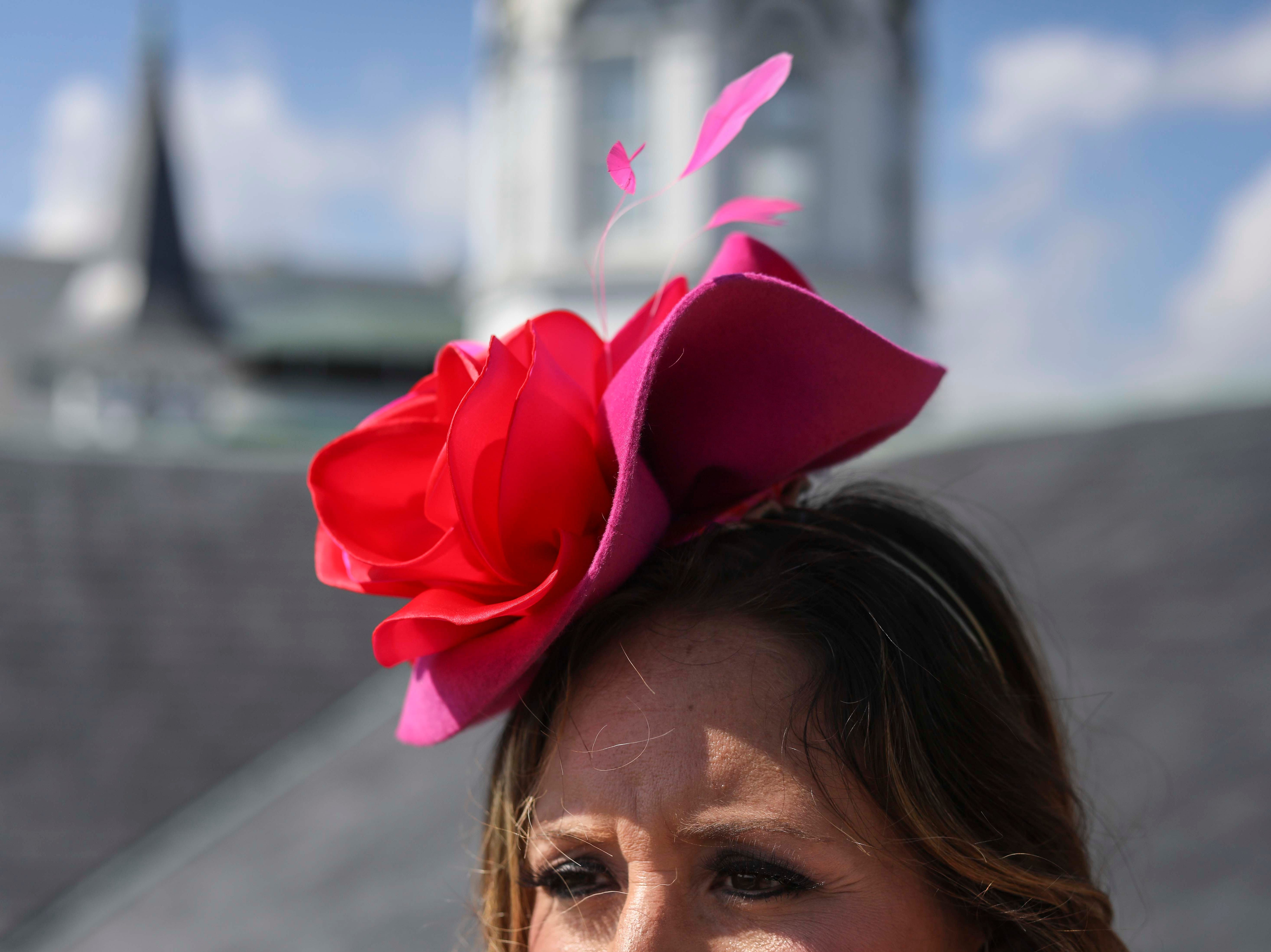 Candice Isa models one of Christine Moore's handmade Cam Hats as well as a Lourdes Chavez dress at Churchill Downs on Wednesday, October 3, 2018.