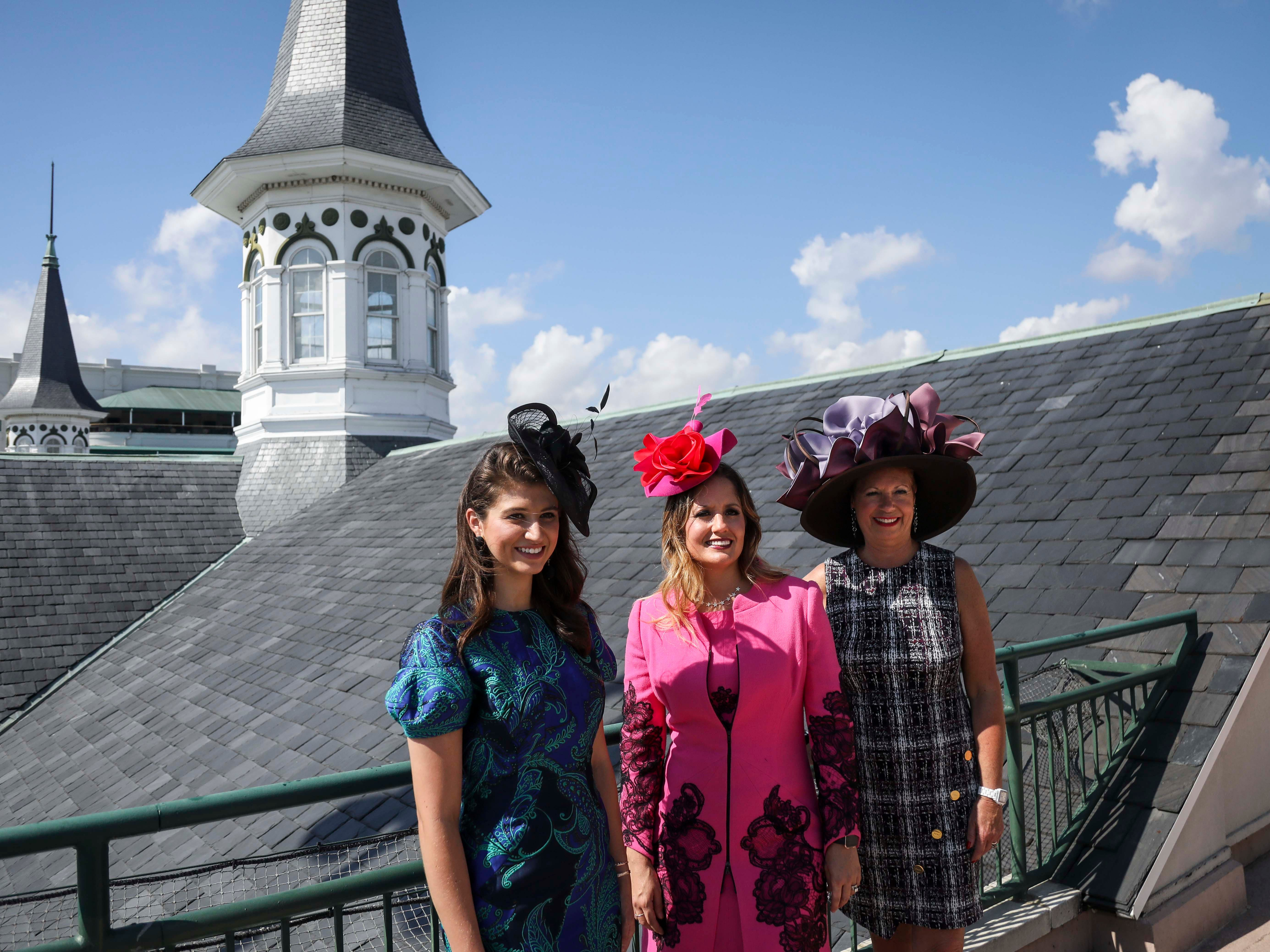 From left to right: Katie Bouchard, Candice Isa, and Patty Ethington don dresses made by Lourdes Chavez and hats made by Christine Moore, track fashion expert and owner of Cam Hats, during an interview with the Courier Journal ahead of the Breeders Cup (November 3) at Churchill Downs on Wednesday, October 3, 2018.