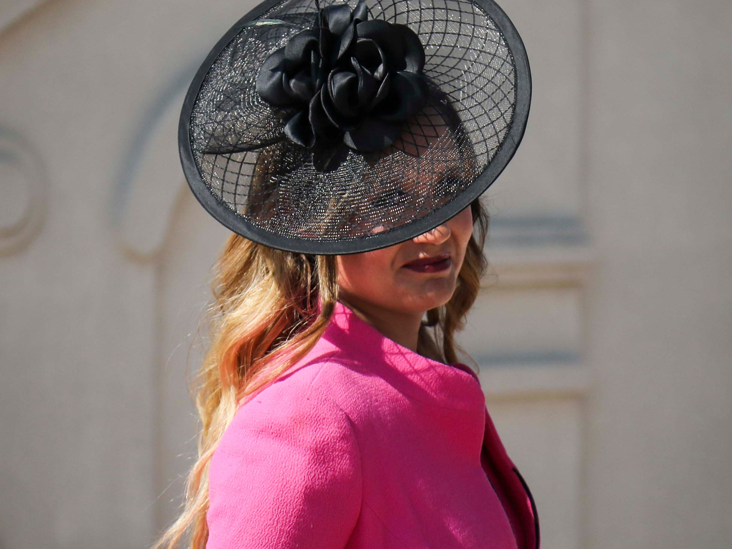 Candice Isa models one of Christine Moore's handmade Cam Hats at Churchill Downs on Wednesday, October 3, 2018.