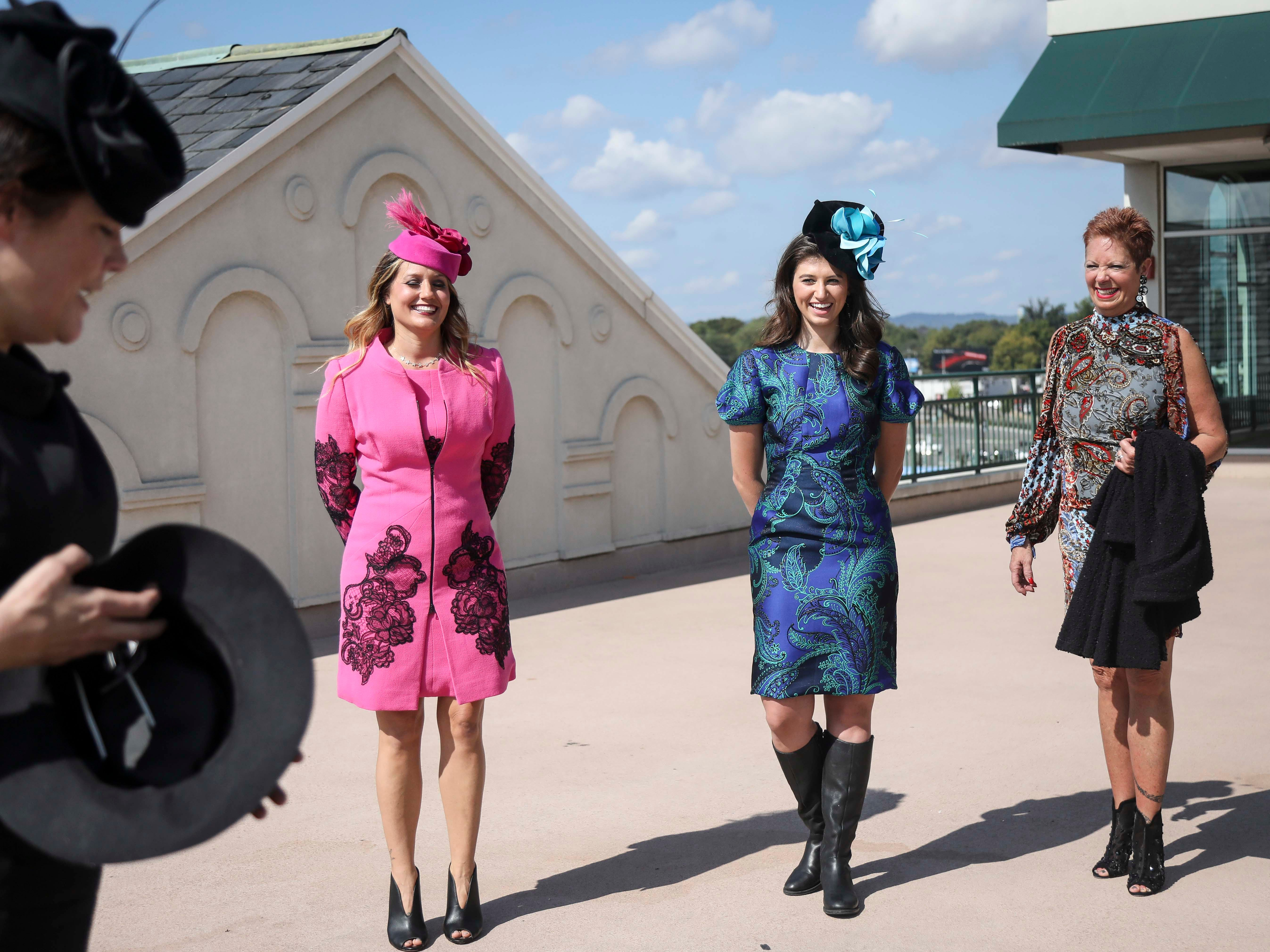 Christine Moore, far left, finds a hat for Patty Ethington, far right, to try on while Candice Isa and Katie Bouchard don dresses made by Lourdes Chavez and hats made by Christine Moore, track fashion expert and owner of Cam Hats, during an interview with the Courier Journal ahead of the Breeders Cup (November 3) at Churchill Downs on Wednesday, October 3, 2018.