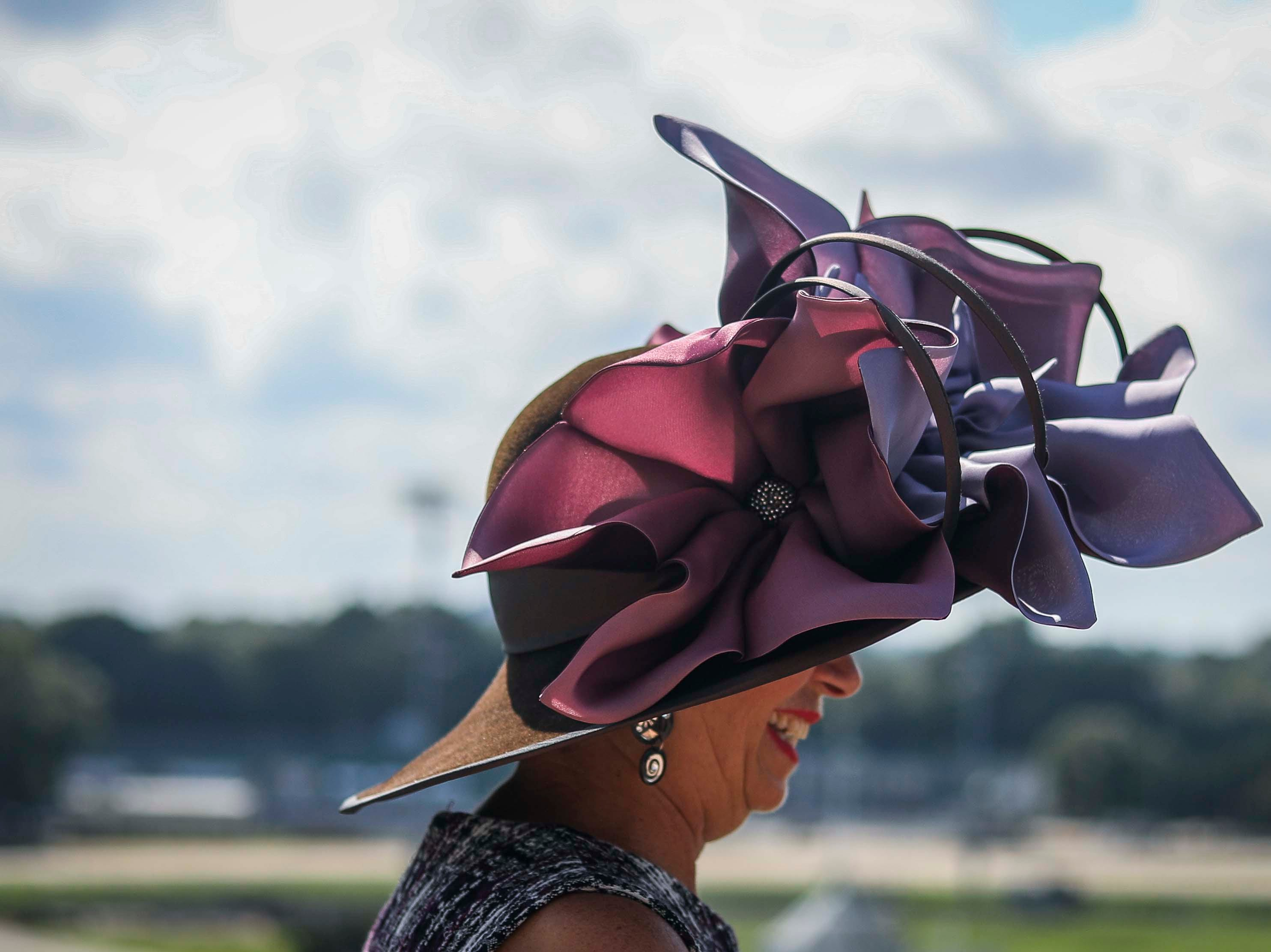 Patty Ethington models one of Christine Moore's handmade Cam Hats at Churchill Downs on Wednesday, October 3, 2018.