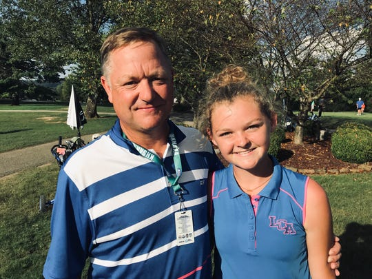 Lexington Christian girls golf coach Will Frye and his daughter, Laney, who won the individual title Wednesday at the state tournament held at Bowling Green Country Club. Lexington Christian also captured the team crown.