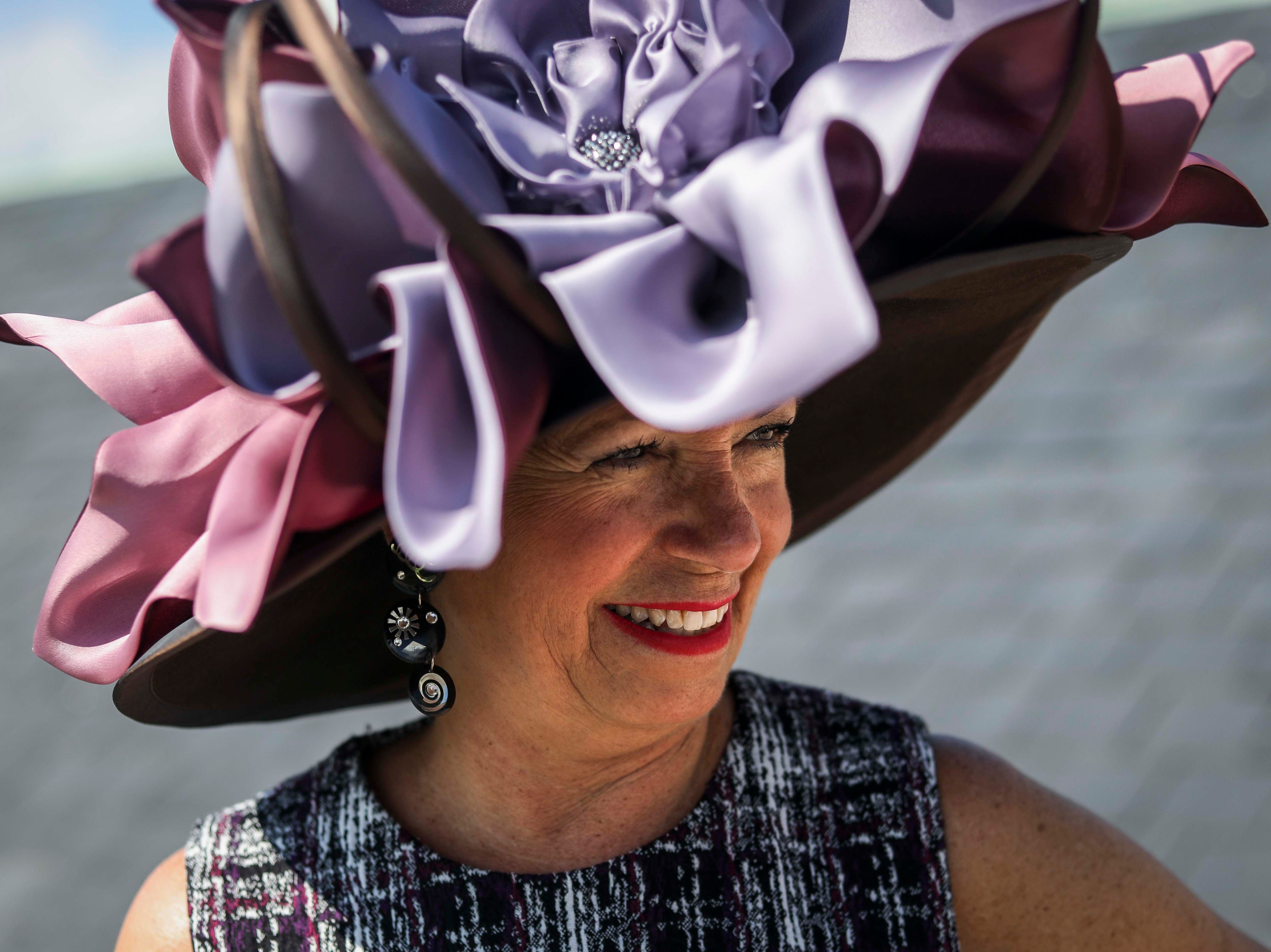 Patty Ethington models one of Christine Moore's handmade Cam Hats as well as a DNKY dress at Churchill Downs on Wednesday, October 3, 2018.