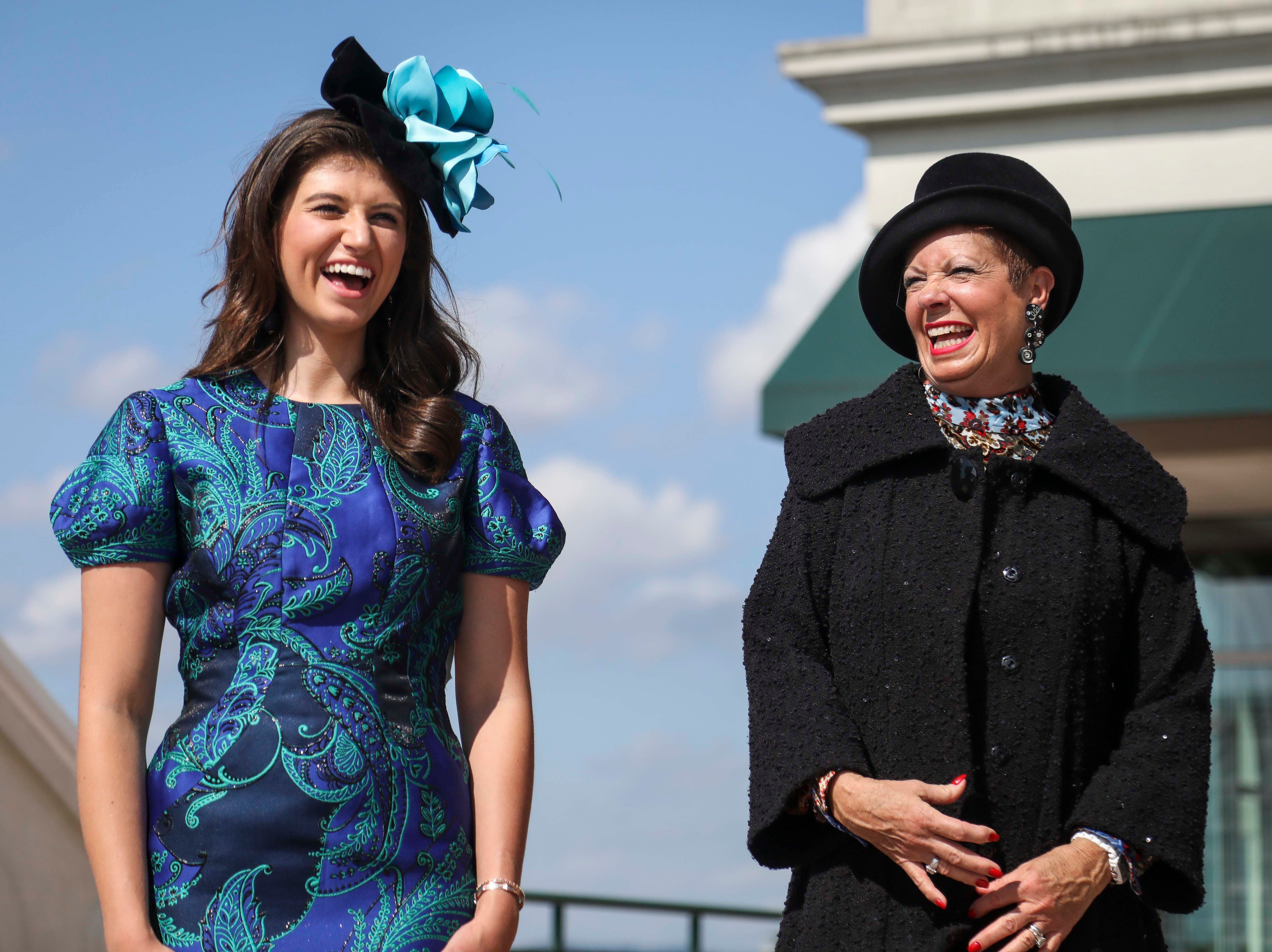 Katie Bouchard, left, and Patty Ethington, right, laugh during an interview with the Courier Journal while sporting dresses made by Lourdes Chavez and hats made by Christine Moore, track fashion expert and owner of Cam Hats, ahead of the Breeders Cup (November 3) at Churchill Downs on Wednesday, October 3, 2018.