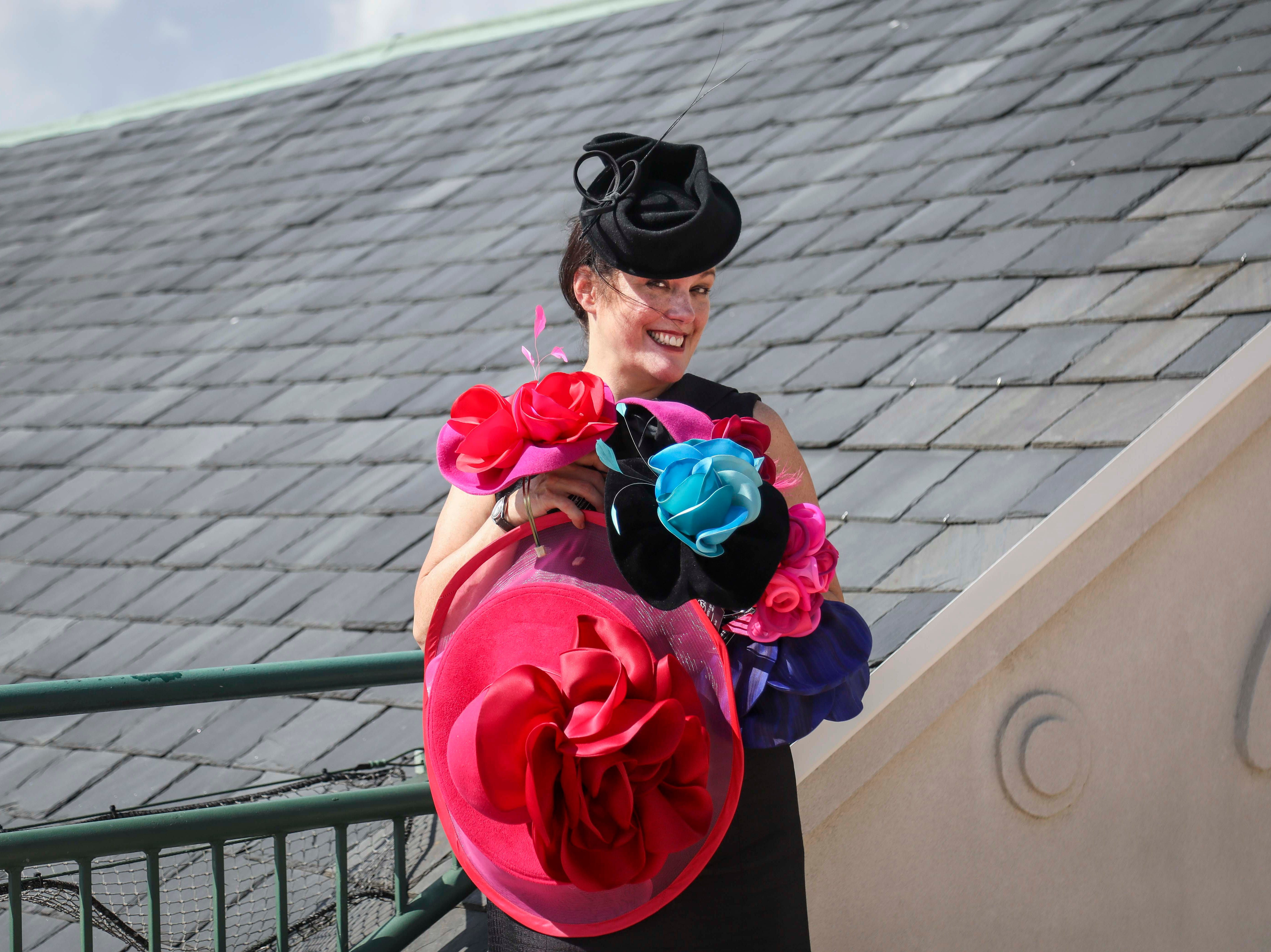 Christine Moore, track fashion expert and hatmaker, poses with her handmade Cam Hats made for the Breeder's Cup (November 2) at Churchill Downs on Wednesday, October 3, 2018.