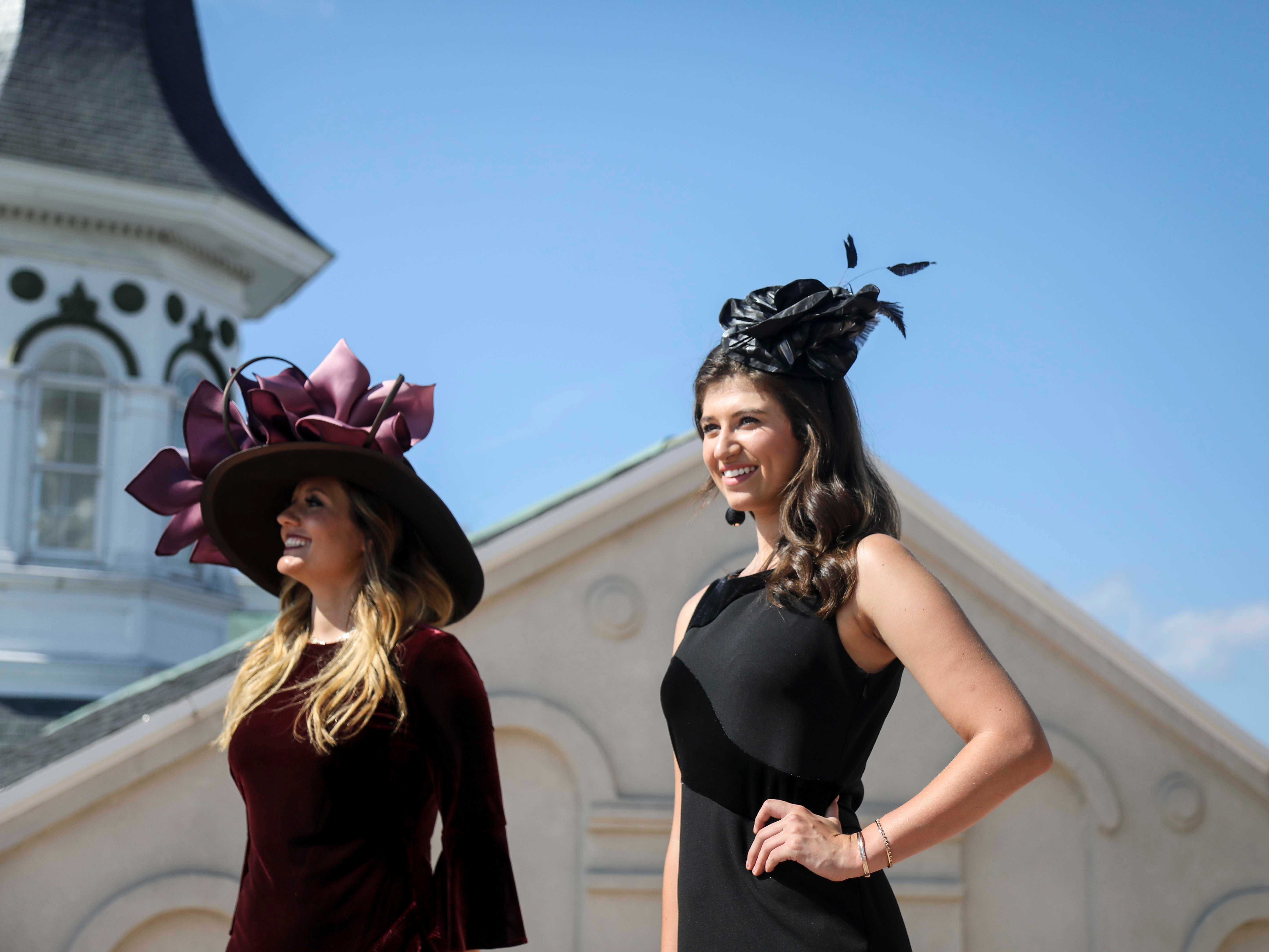 Candice Isa and Katie Bouchard model hats made by Christine Moore, track fashion expert and owner of Cam Hats, during an interview with the Courier Journal ahead of the Breeders Cup (November 3) at Churchill Downs on Wednesday, October 3, 2018.