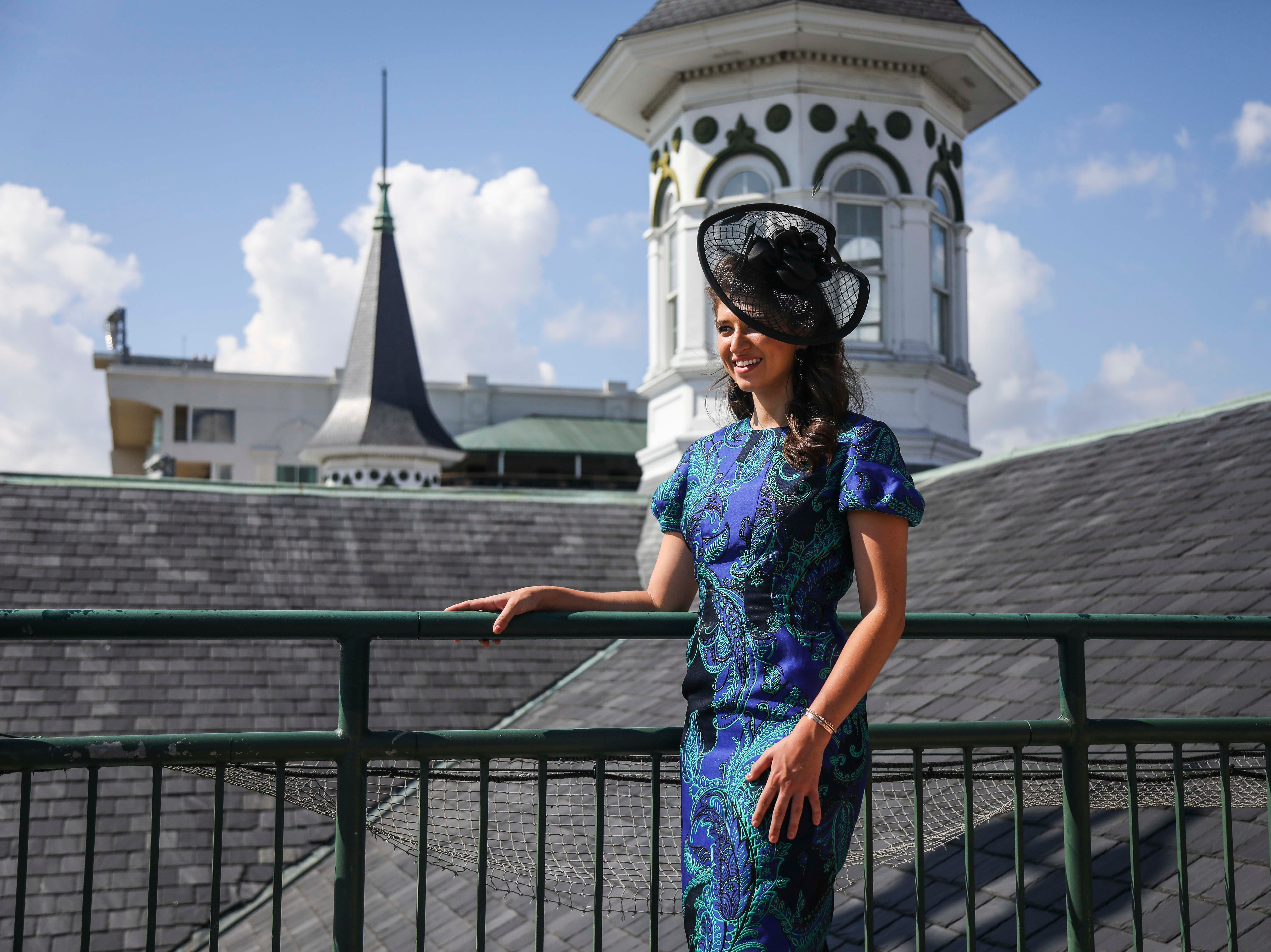 Katie Bouchard, Miss Kentucky, models one of Christine Moore's handmade Cam Hats as well as a Lourdes Chavez dress at Churchill Downs on Wednesday, October 3, 2018.