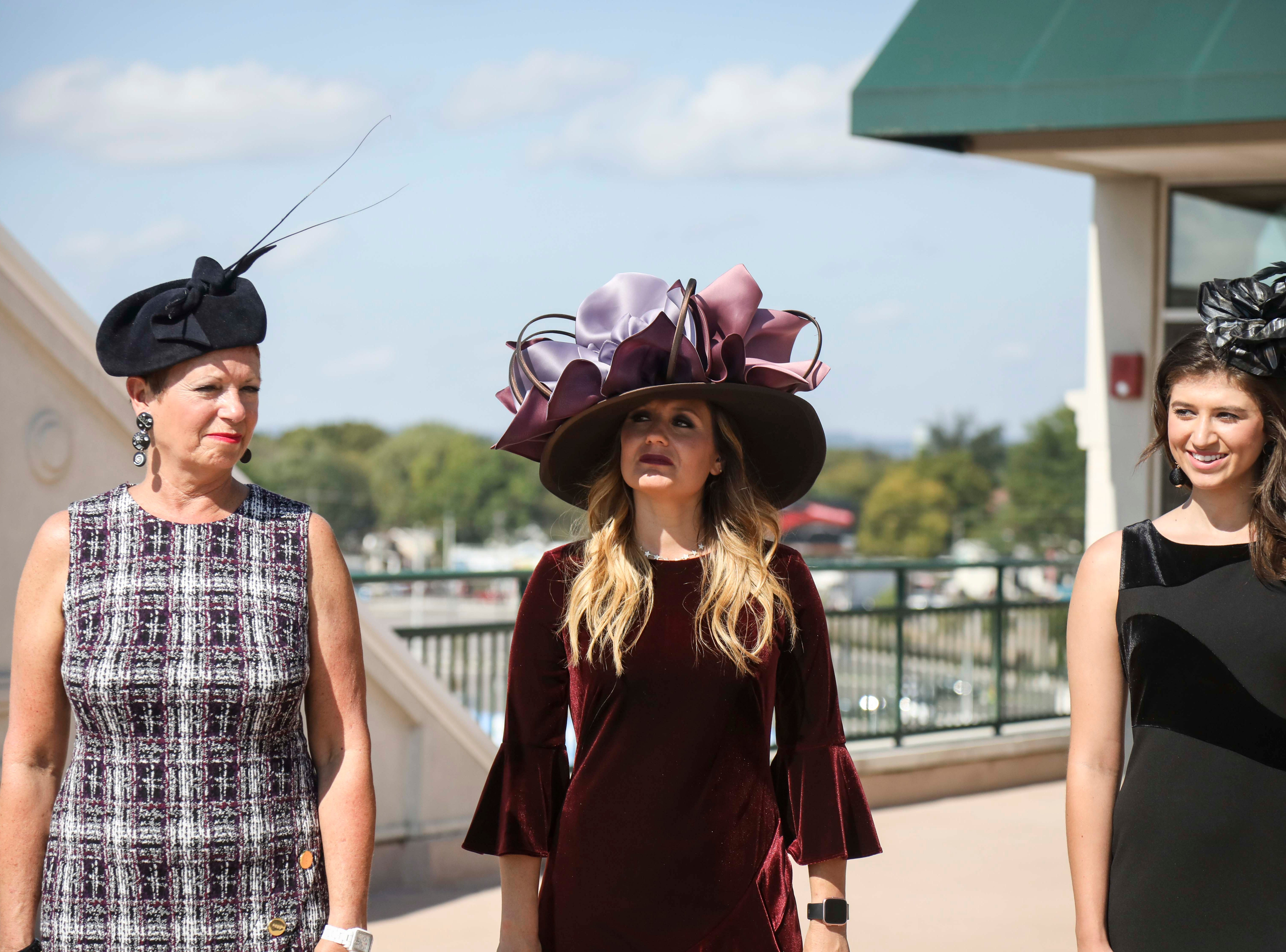From left to right: Patty Ethington, Candice Isa and Katie Bouchard don hats made by Christine Moore, track fashion expert and owner of Cam Hats, during an interview with the Courier Journal ahead of the Breeders Cup (November 3) at Churchill Downs on Wednesday, October 3, 2018.