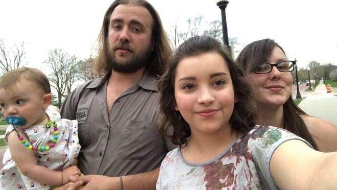 Joe Mull (left) poses with his daughter Amelia (far left), his fiance Sarah Morris (right) and cousin Ivy Faberge.