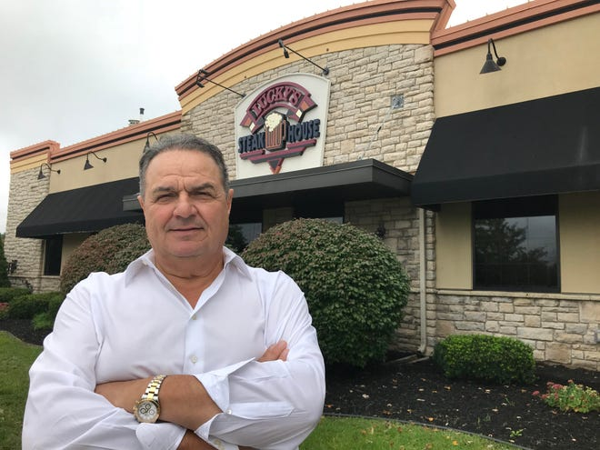 Lucky Vasilakis, owner of Lucky's Steakhouse, stands outside the new restaurant in Okemos on Tuesday, Oct. 2, 2018. The business opened this week.