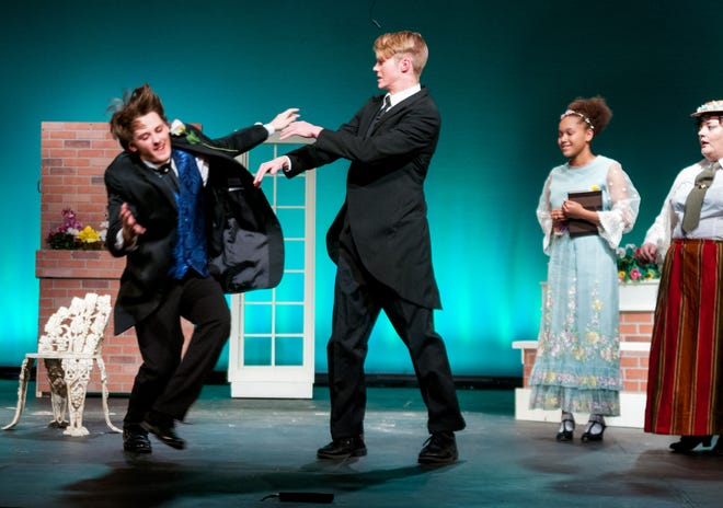 """Justus Bartman pushes Deken Foster, while Anyssa Hanna and Mary Frankenfield look on during practice for """"The Importance of Being Earnest."""""""