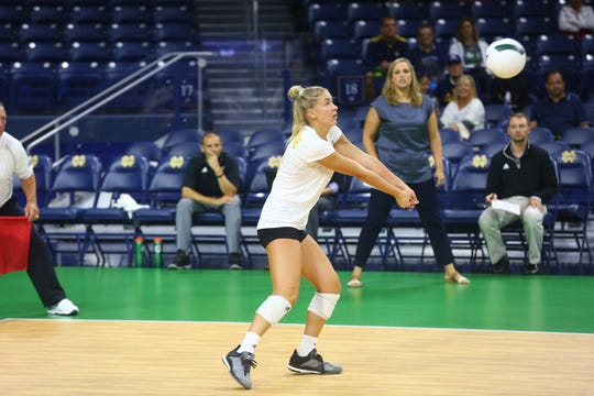 Highland grad Ashton Terrill digs up a hit for the Northern Kentucky women's volleyball team.