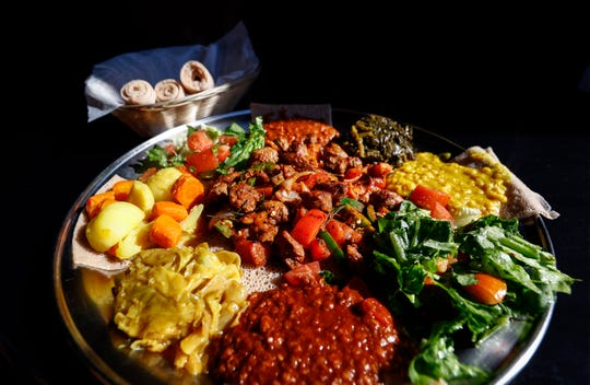 Blue Nile Ethiopian Kitchen's Corniece Platter comes with your choice of meat with a variety of veggies, salads and wats (Ethiopian stews).