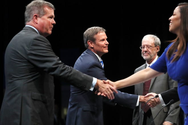 Democrat Karl Dean and Republican Bill Lee shake hands with the moderators after the gubernatorial debate at the University of Memphis' Michael D. Rose Theater in Memphis on Tuesday, Oct. 2, 2018.