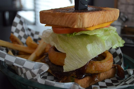 The BBQ Burger has a half pound Angus patty with bacon, American cheese, barbecue sauce and onion rings on Texas toast. It's $10.95 and comes with fries, coleslaw, onion rings or a side salad.