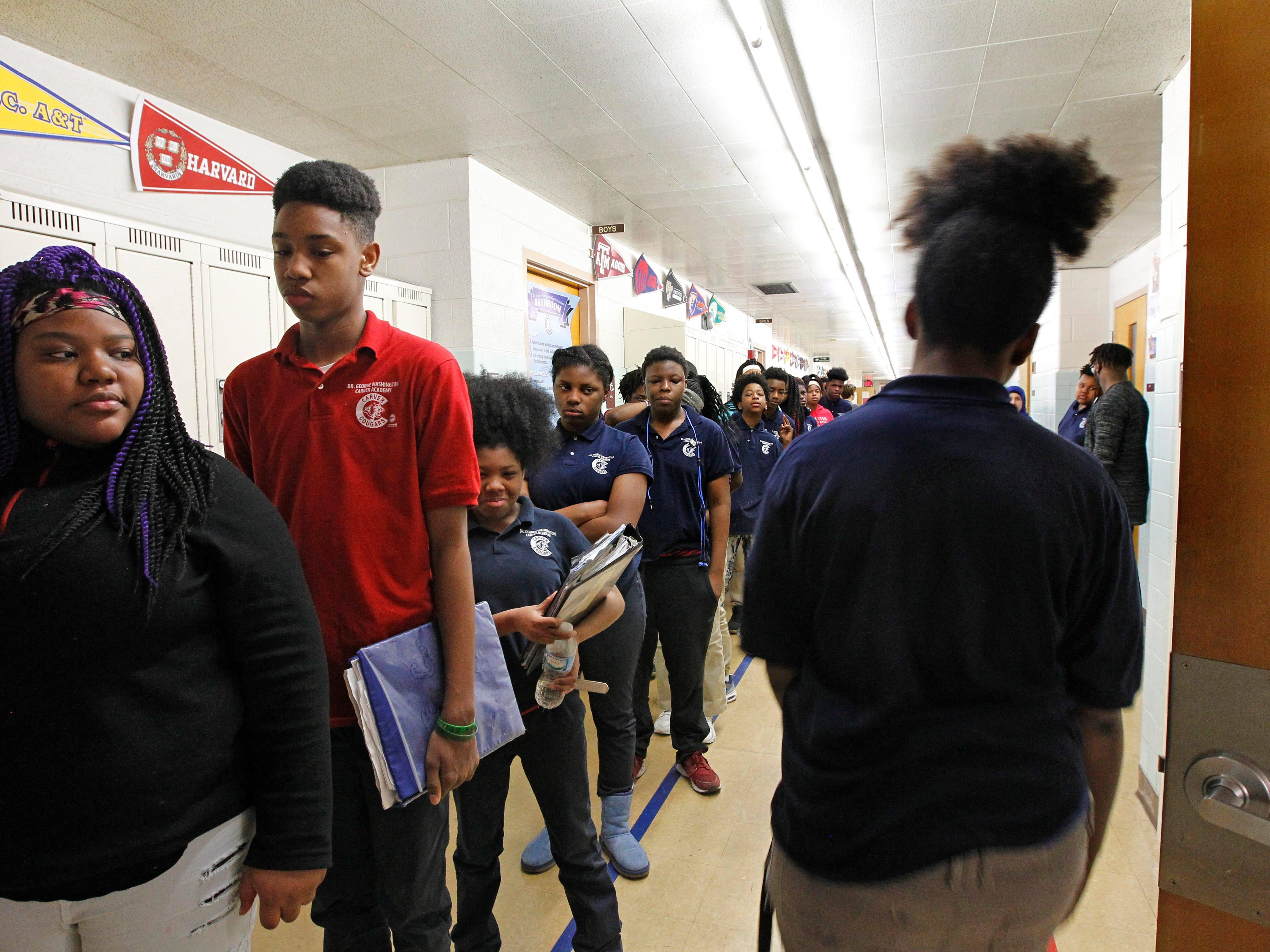 Students transition from class to class on  at Carver Academy.
