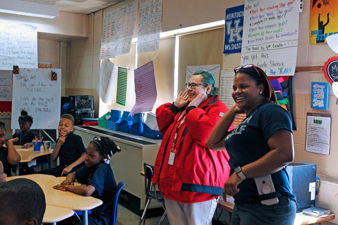 Julie Meadow (center), City Year Americorp staff, participates in motivational drills with third-grade teacher Symona Gregory Harvey, 8, at  Dr. George Washington Carver Academy at 1900 North 1st Street, Milwaukee on Wednesday, May 16, 2018.  Gregory is a former City Year staff. This is her first year at Carver and she was recently named teacher of the year at the school.