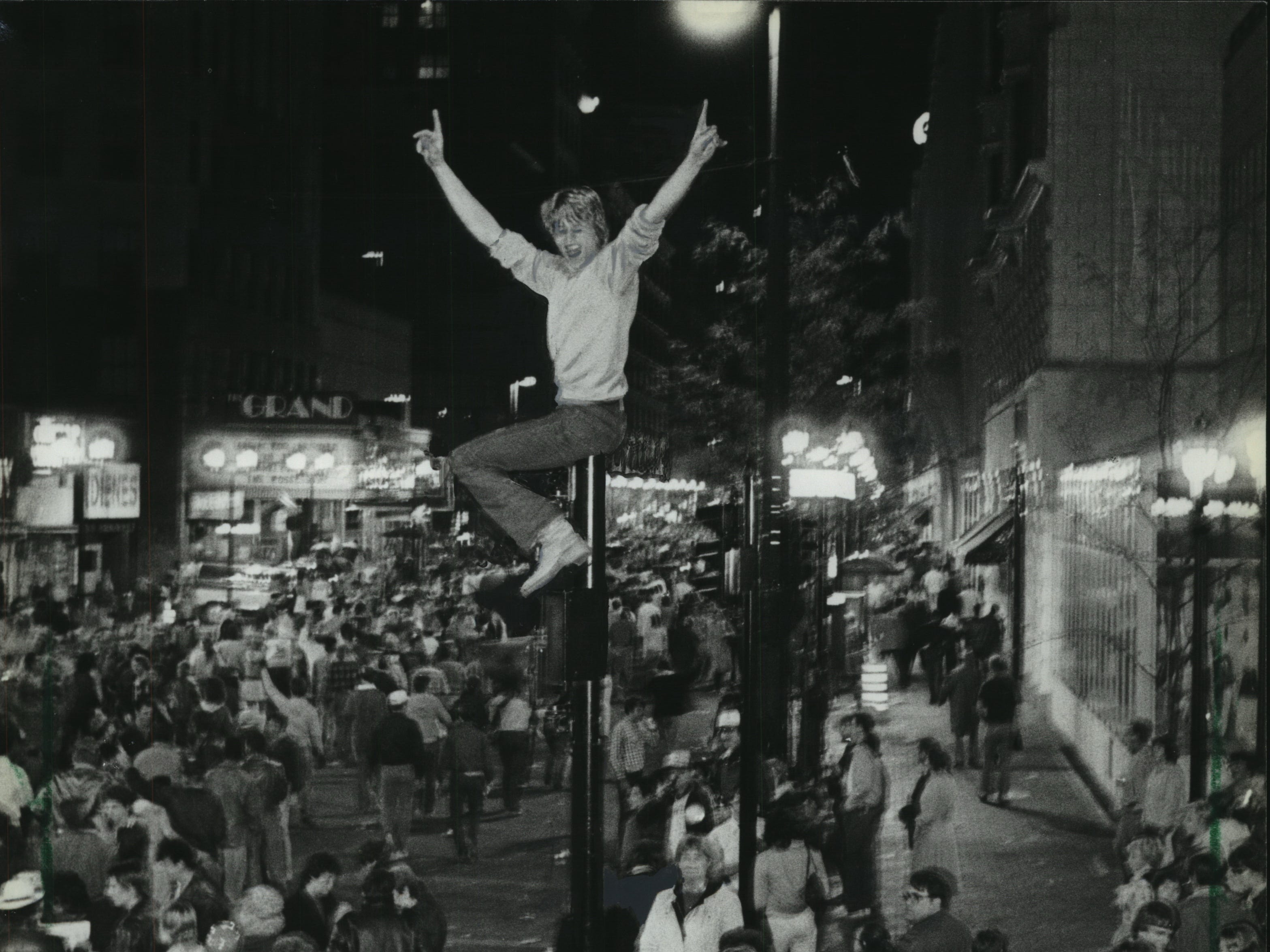 Fans pour onto (and above) Wisconsin Avenue to celebrate the Milwaukee Brewers winning the pennant on Oct. 10, 1982. A spontaneous parade, begun after the Brewers beat the Angels in the American League Championship Series at County Stadium, lasted more than seven hours. This photo was on the front page of the Oct. 11, 1982 Milwaukee Journal.