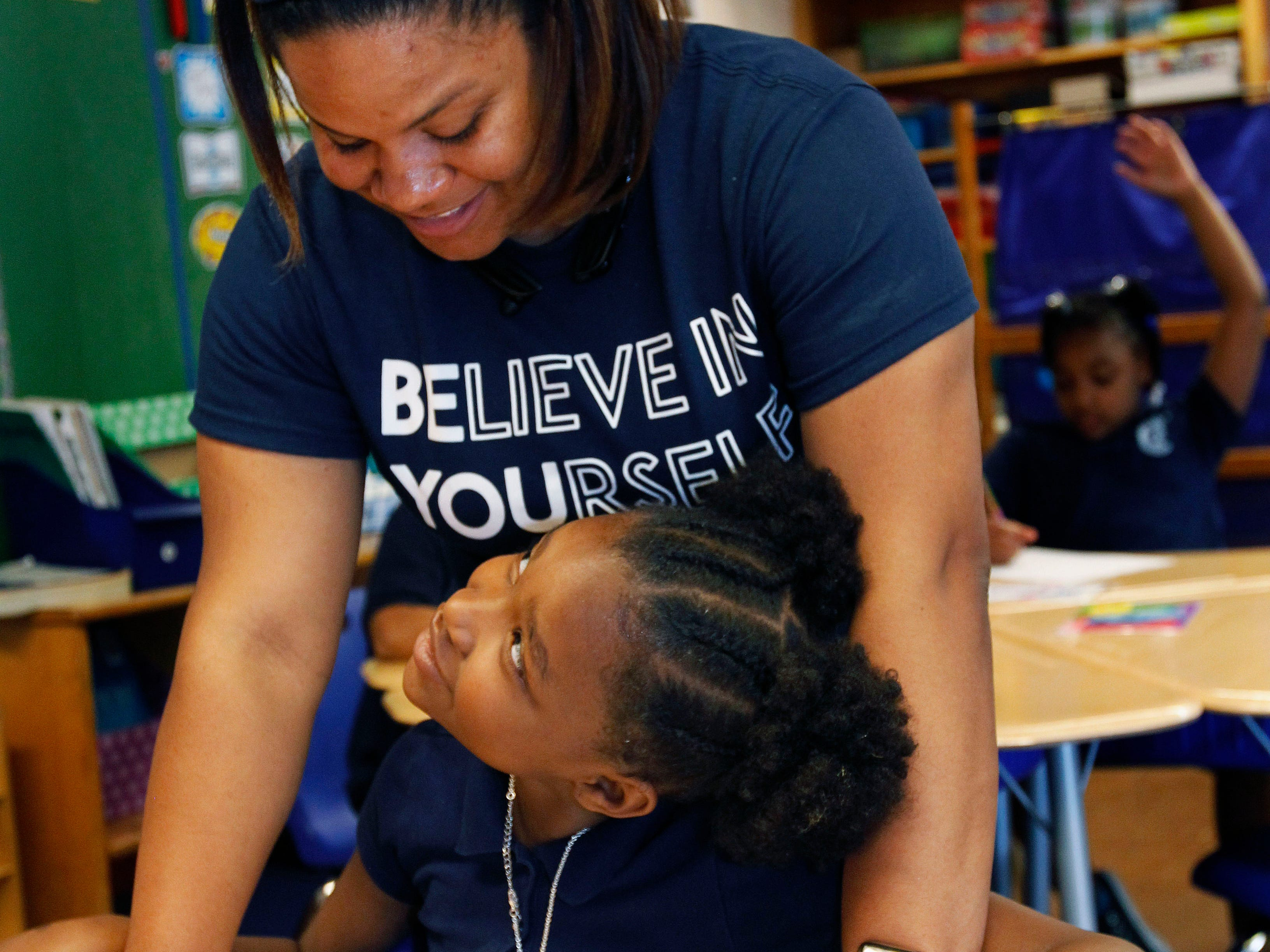 Third grade teacher Symona (cq) Gregory Harvey works with Kamariana Brown, 8, in preparation for a math test May 16 at Carver Academy. It's the first year at Carver for Gregory, who  is a former City Year staff member.  She was recently named teacher of the year at the school.