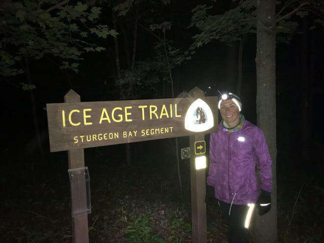 Annie Weiss poses for a photo at the final segment of her 1200-mile Ice Age Trail run. She broke a record for fastest time running the trail on Sunday, Sept. 30 at 1 a.m.