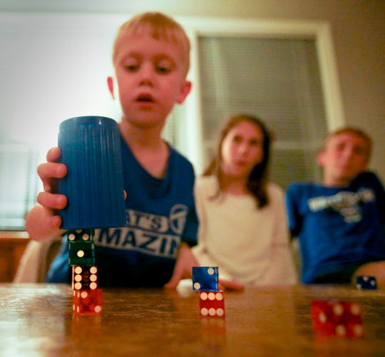 """Colin End, 5, demonstrates his dice stacking skills in the family's Whitefish Bay home. Colin's skill went viral from a video that brother Tommy produced and posted to YouTube and was noticed by """"Live with Kelly and Ryan."""" Colin recently appeared on the show."""