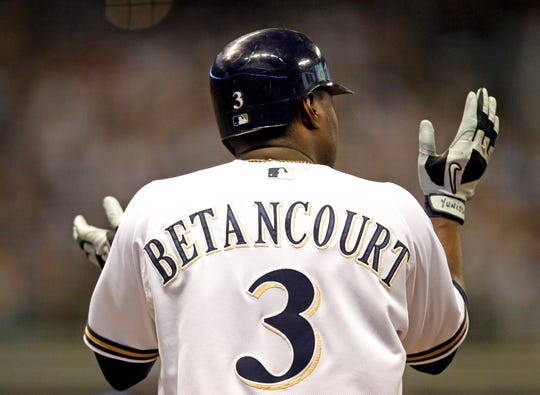Yuniesky Betancourt applauds the lead after his RBI single in the 6th of Game 5 of the NLDS in 2011.