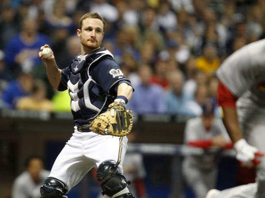Jonathan Lucroy throws Edwin Jackson out at first base in the top of the 4th inning  during the second Brewers Cardinals game of the NLCS series at Miller Park in Milwaukee, Wisconsin, October 10, 2011.