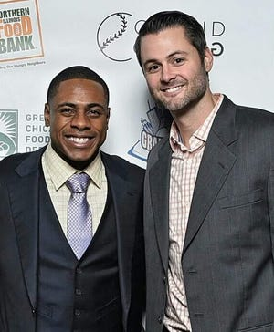 Curtis Granderson (left) and his childhood friend Adam Lewis poses at a charity event.