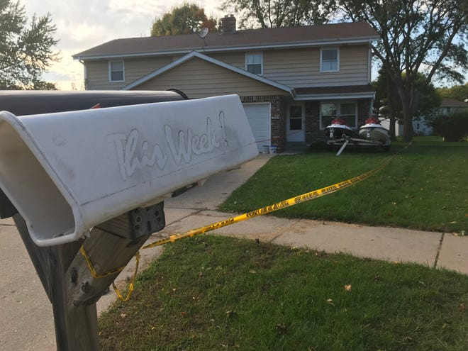 Crime scene tape cordons off a section of a Waukesha townhouse on Albany Court where two men were found dead Oct. 2. Police suspect the deaths were the result of a murder-suicide.