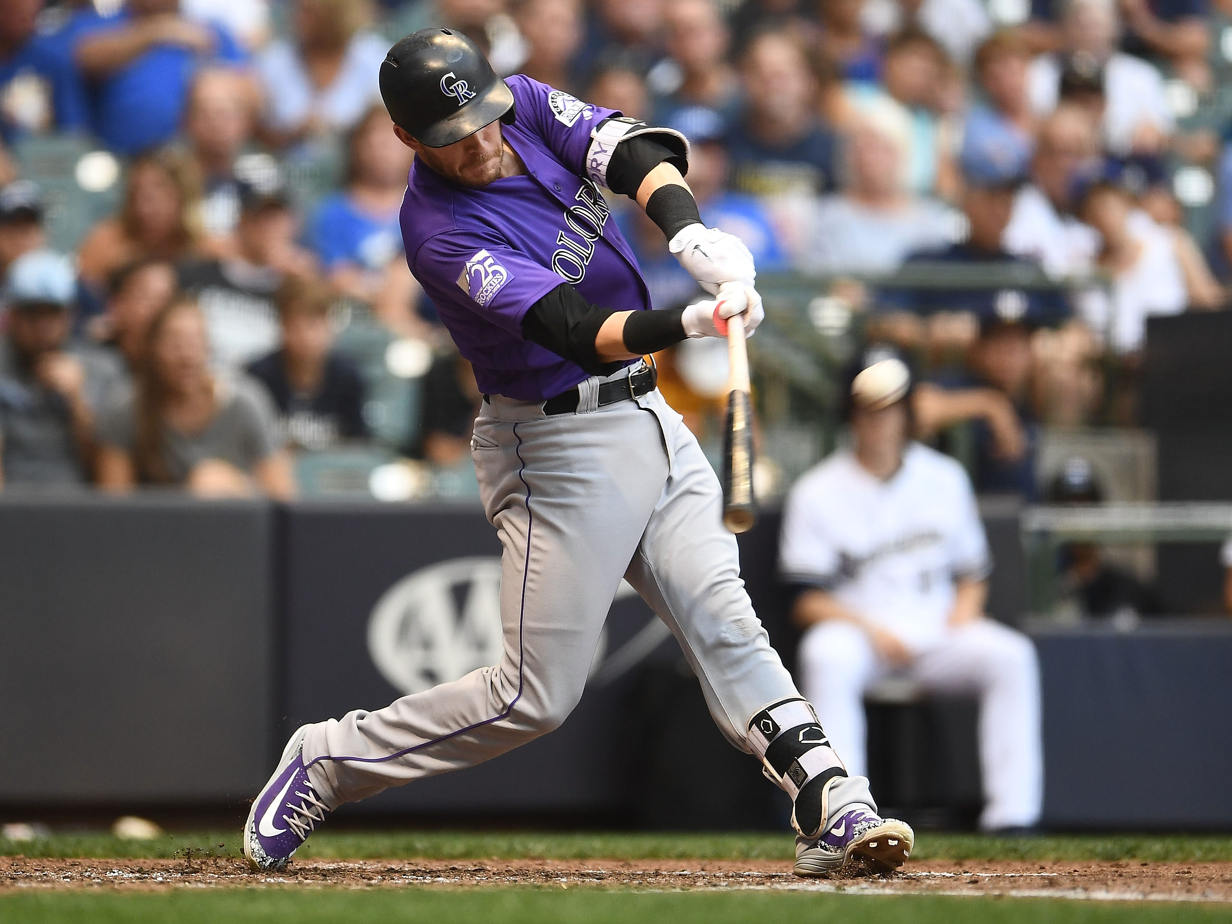 MILWAUKEE, WI - AUGUST 04:  Trevor Story #27 of the Colorado Rockies hits a two run home run during the fourth inning of a game against the Milwaukee Brewers at Miller Park on August 4, 2018 in Milwaukee, Wisconsin.  (Photo by Stacy Revere/Getty Images)
