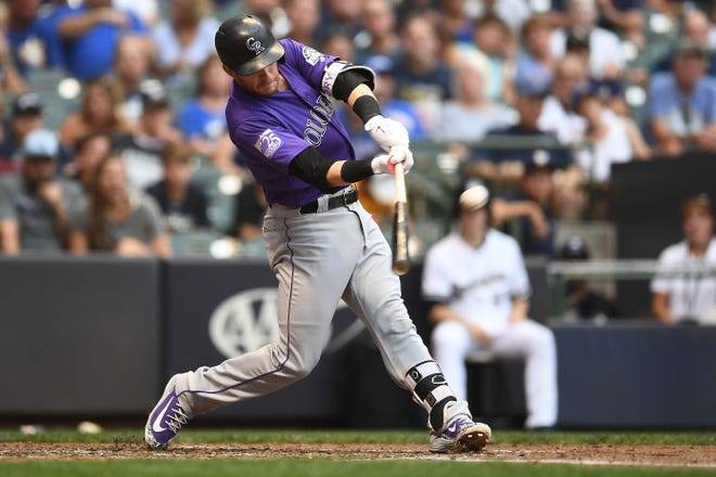 Trevor Story of the Colorado Rockies hits a two-run homer against the Brewers Aug. 4 at Miller Park.