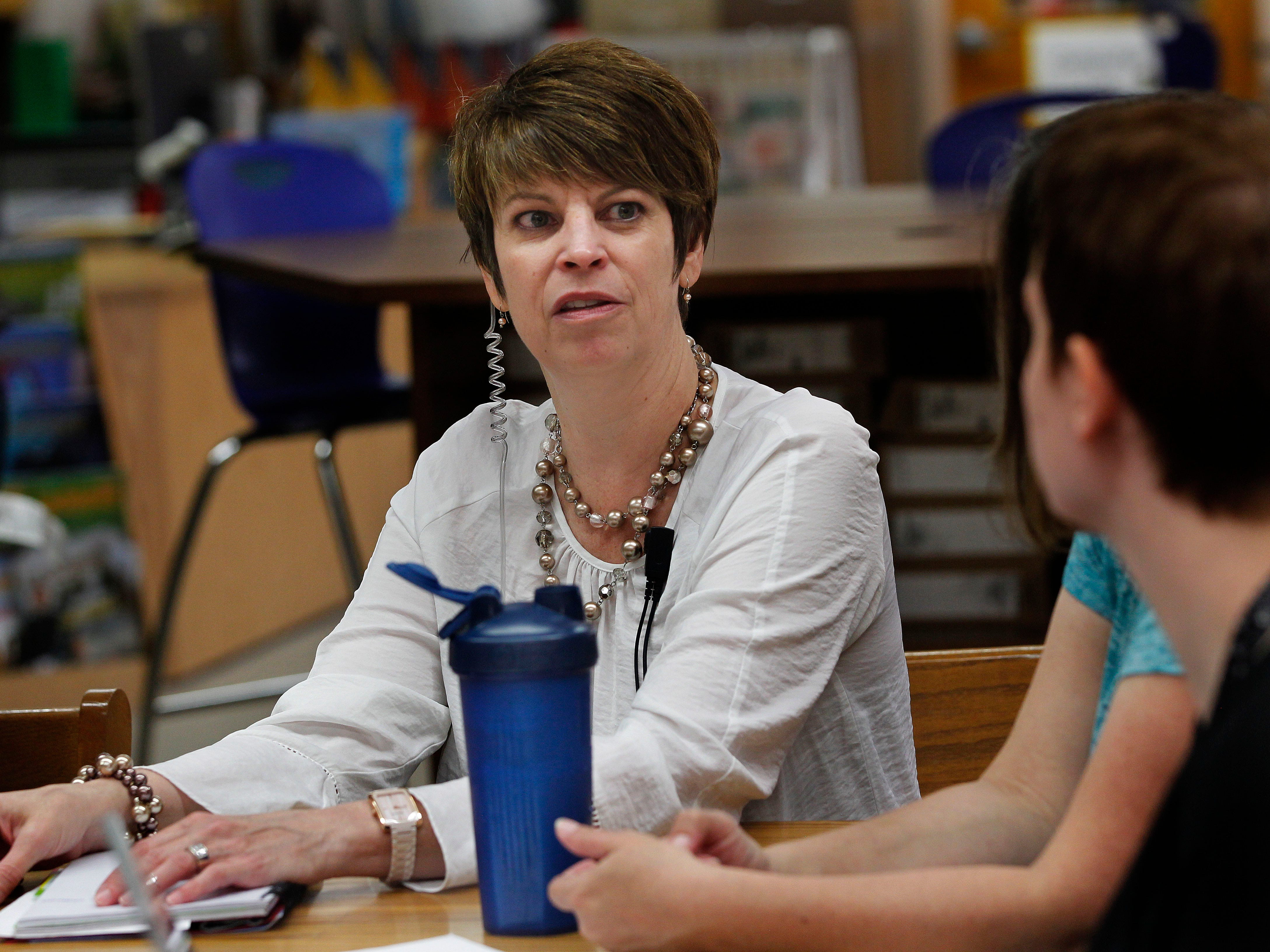 Kristin Hinds, principal at Carver Academy, (left) discusses student progress May 16 during a partners meeting.