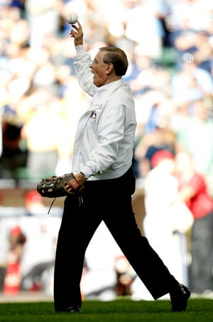 Commissioner Alan H. (Bud) Selig throws out the ceremonial first pitch.  Milwaukee Brewers grounds crew wets down the infield just before first pitch. The Milwaukee Brewers and the Arizona Diamondbacks play game 5 of the NLDS at Miller Park on Oct. 7, 2011.