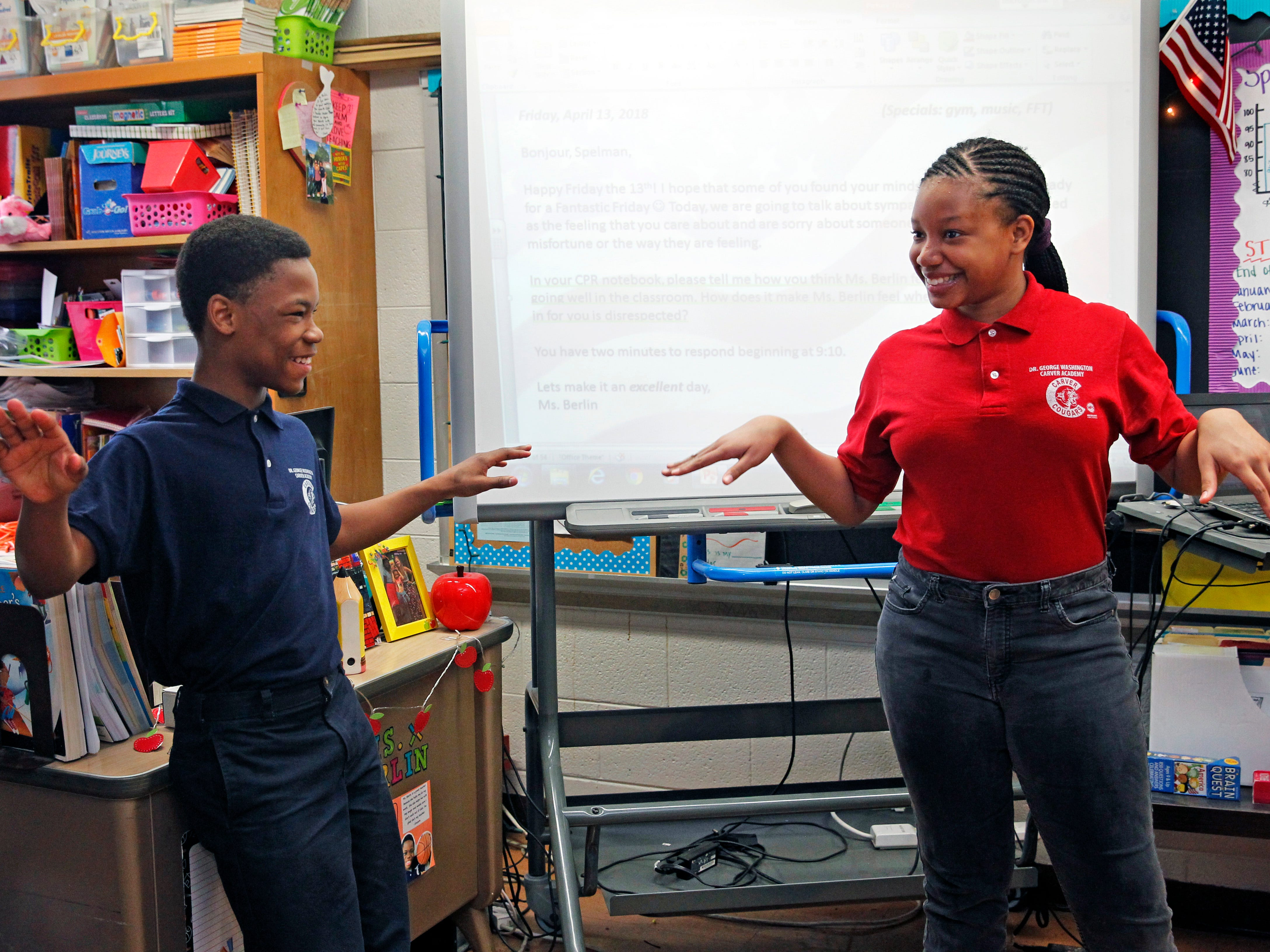 "Edited captions by Debby Davis - Sixth-graders Deangelo Williams and Trinity Coffey participate April 13 in the ""Circle of Power and Respect"" exercise at Carver Academy. The activity aims to helps build strong social relations among students and faculty."