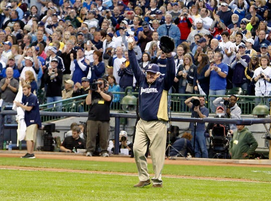 Bob Uecker acknowledges the Miller Park crowd as he takes the mound to throw out the first pitch in the 2011 NLDS against the Arizona Diamondbacks.