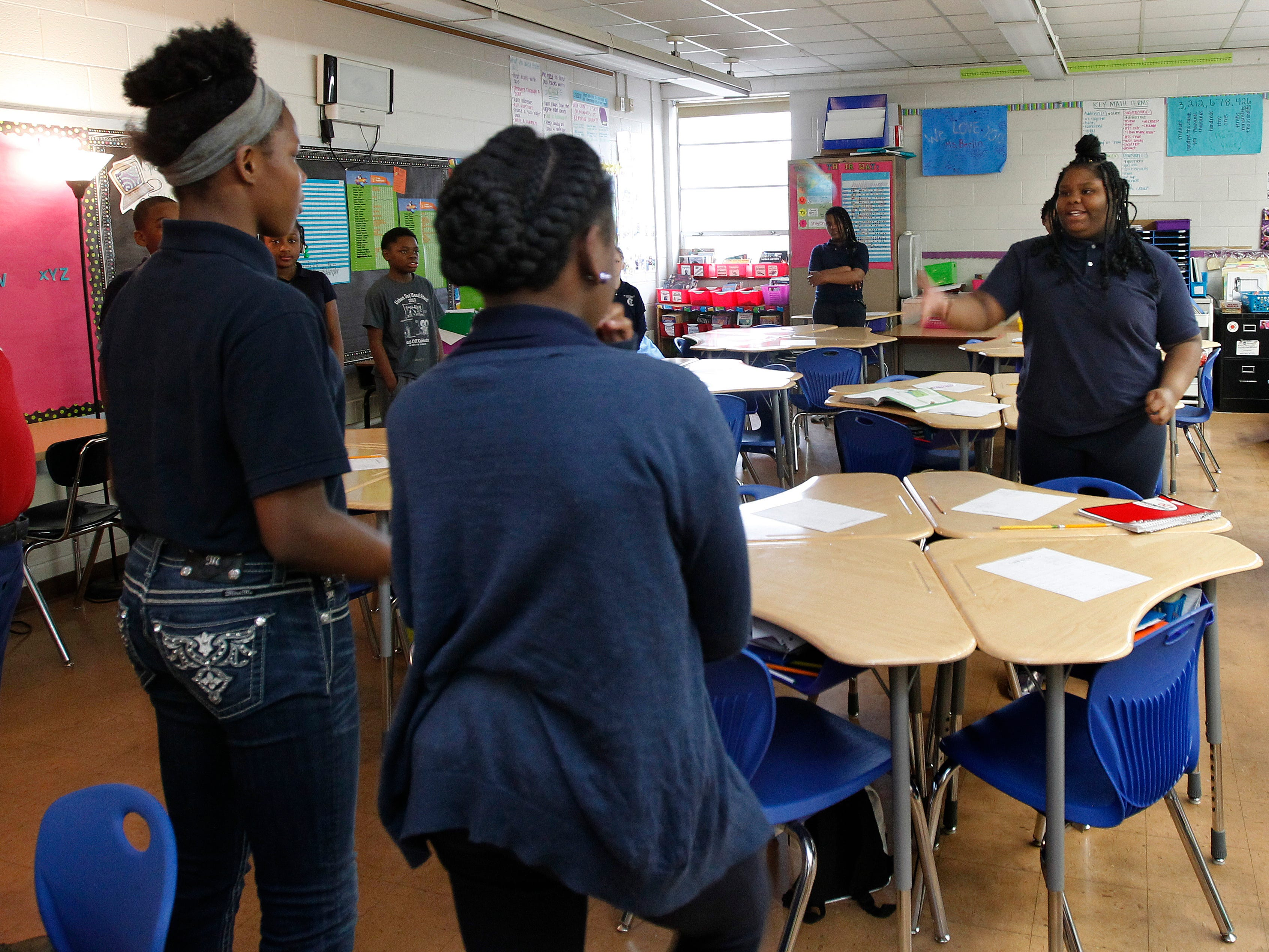 Anievia (cq) Harps, 6th grader in the center of circle, participate in the 'Circle of Power and Respect' activity at Carver Academy on Friday, April 13, 2018. This activity helps build strong social relations among students and faculty.
