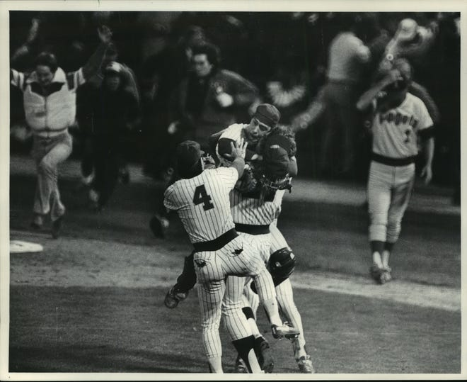 Milwaukee Brewers catcher Ted Simmons jumped all over reliever Pete Ladd after Sunday's game at County Stadium. Third baseman Paul Molitor (4) was ready to pile on after the Brewers beat the California Angels, 4-3, to reach the World Series.